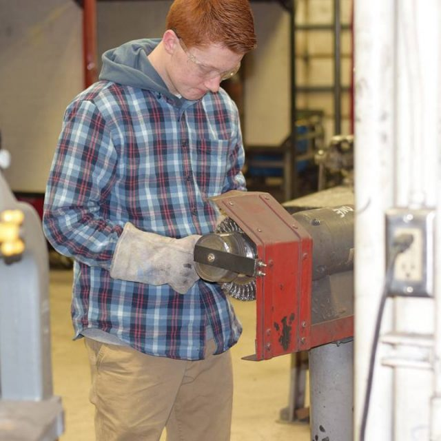 Ryan NcNelly works on a project in a welding classhellip