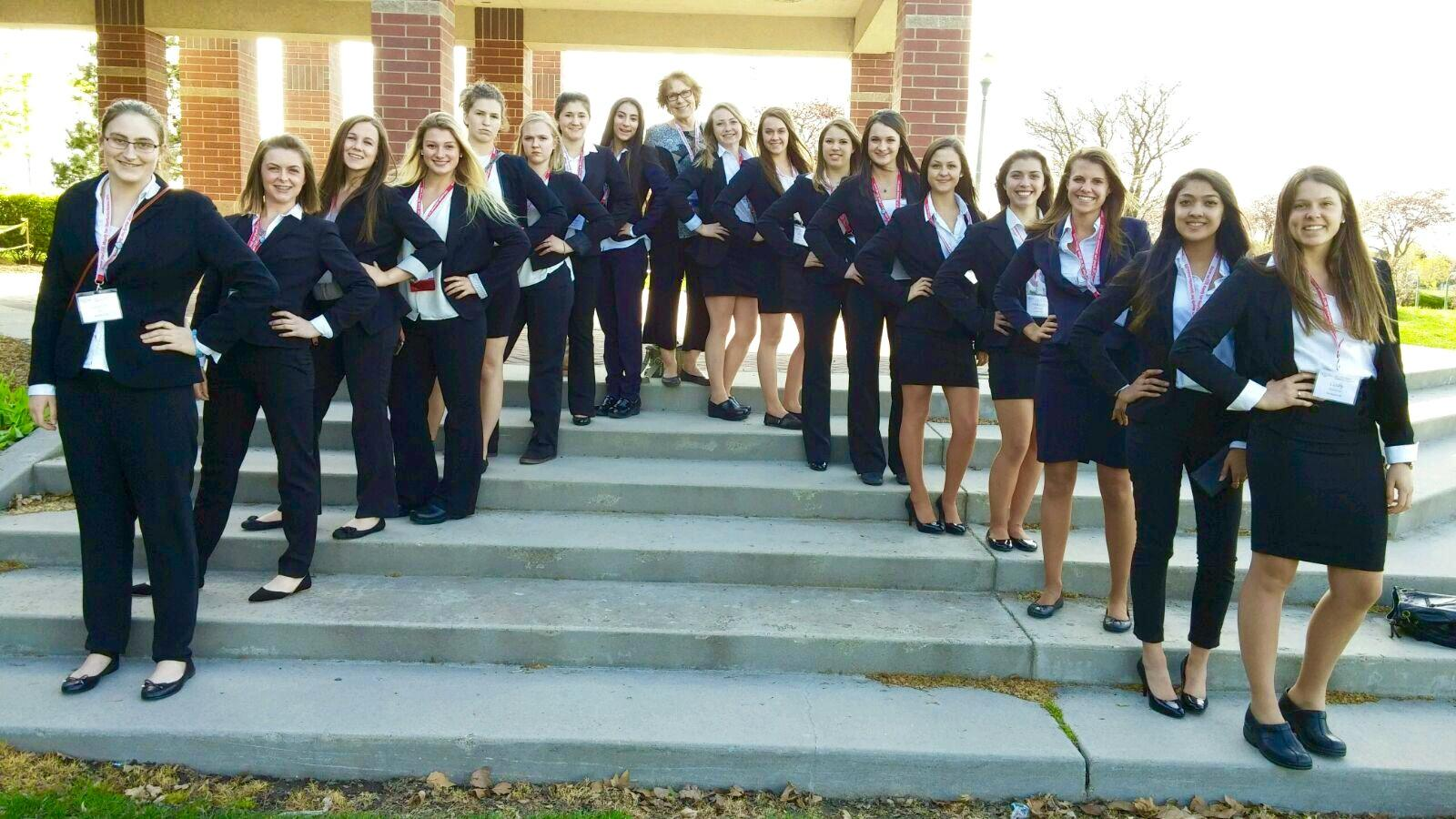 HOSA members and their adviser pose for a picture while attending HOSA State