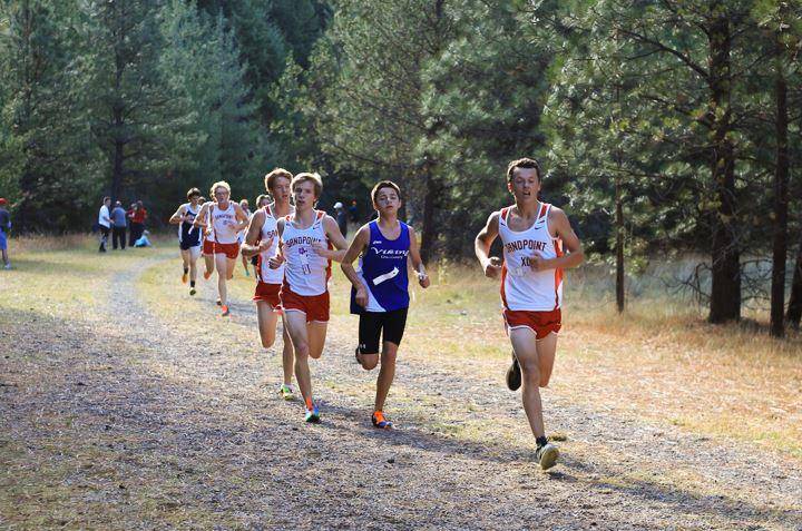 Junior Clay Rasmussen led the boys' pack on the second lap. They were able to stay together across the finish line to earn first place as a team in the meet with 30 points.