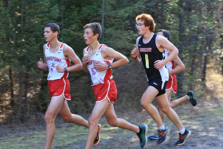 (Left to Right) Sophomore Hyrum Hunsaker, freshman Kieran Wilder, and freshman Conner Matlosz ran as a group on the first lap. Hyrum ran a time of 20:50, Conner ran a 21:11, and Kieran ran a 21:15.
