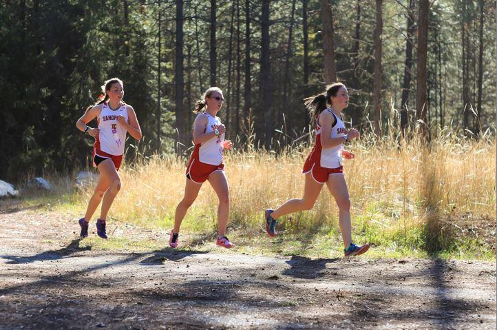 (Right to Left) Junior Rainey Woodward, senior Claire Pierce, and sophomore Sharon Rowe placed fifth, eighth, and sixth respectively.