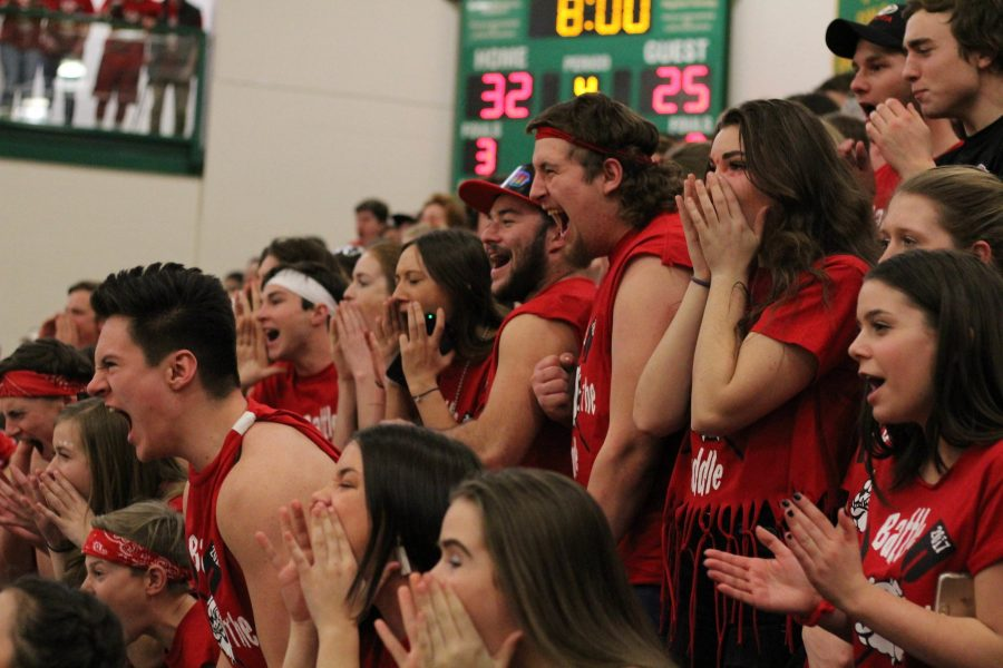 The crowd shouts and screams as the decibel reading is taken before the start of the fourth quarter during the boy's basketball game.