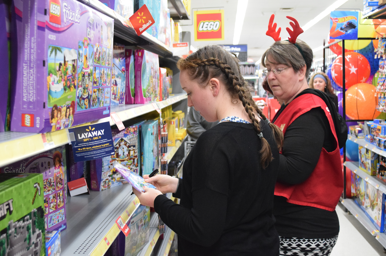 Students volunteer to help with the annual toy buy.
