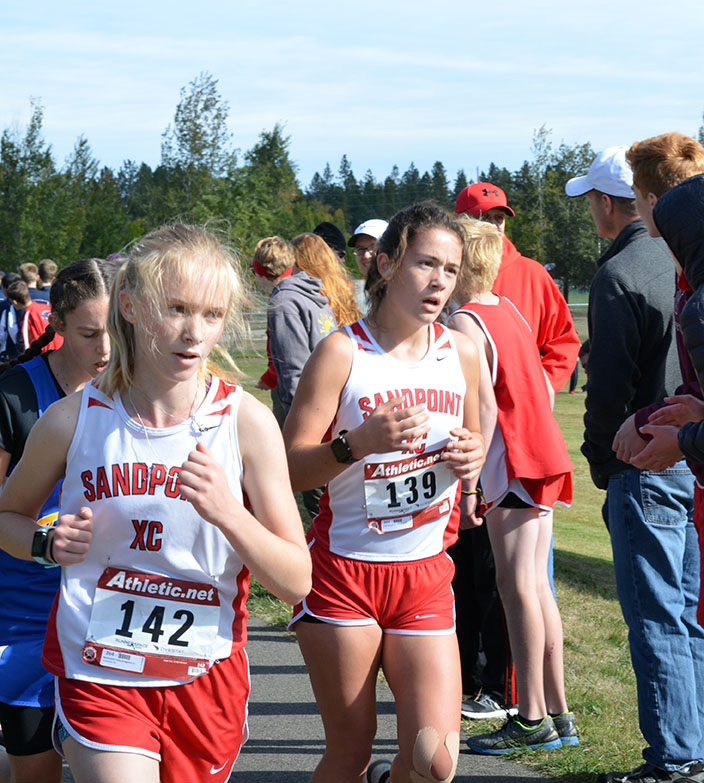 Mackenzie+Suhy-Gregoire+and+Lydia+Nelson+run+in+the+girls+JV+cross+country+race.