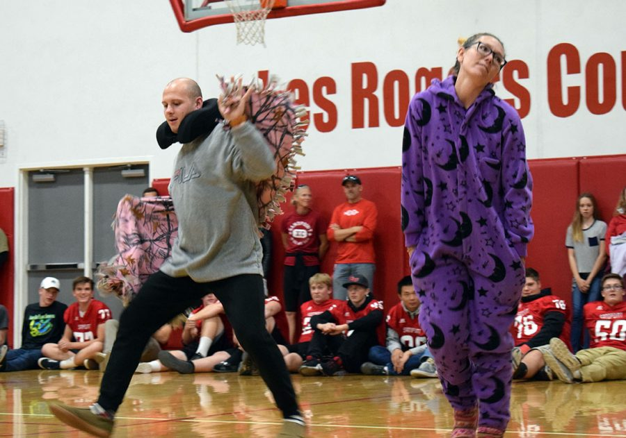 Teachers Kevin Hutchens and Zabrielle Dillon strut their stuff while showing off outfits for the pajama dress up day on Tuesday.