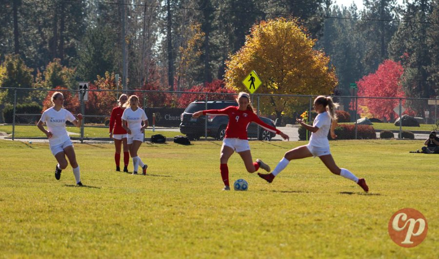 Freshman Emma Thielbahr attempts to pass a ball past a defender.