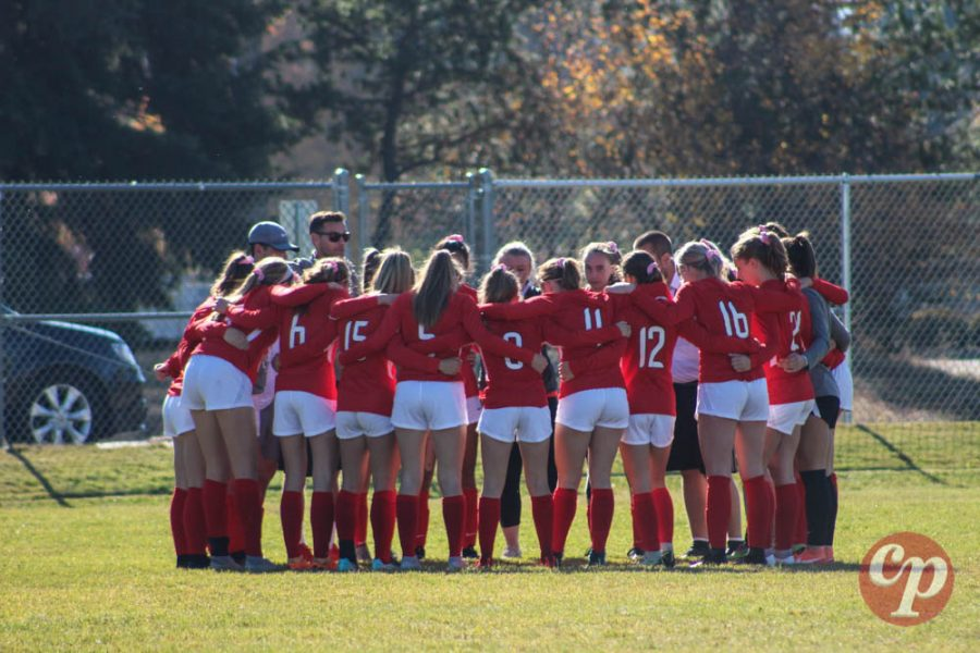 Sandpoint huddles in preparation for the start of the game.