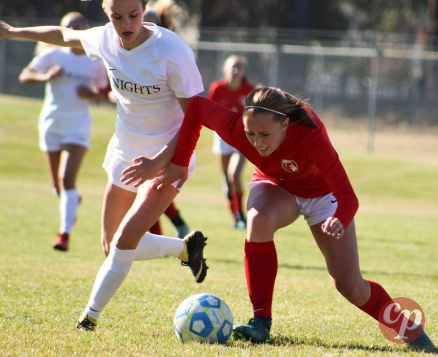 Junior Emi Lynch is pushed to the ground by a Bishop Kelly player.
