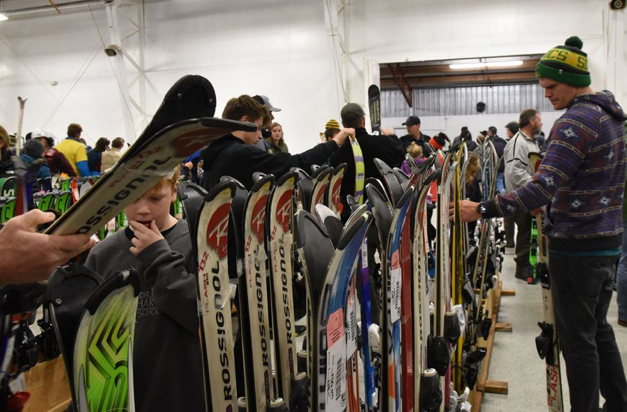 The ski swap bustles with people purchasing new equipment for winter.