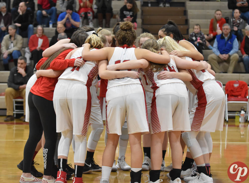 The+Lady+Bulldogs+huddle+up+before+their+game+against+Timberlake.+