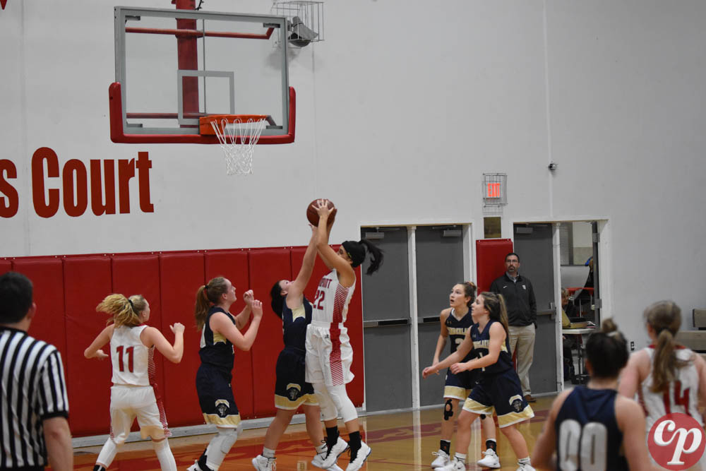 Sophomore+Bella+Phillips+rebounds+the+ball+and+attempts+to+make+a+basket.+