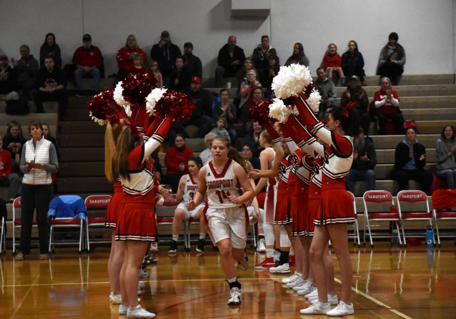 Junior Maddie Morgan runs through the line of cheerleaders as she is announced for starting line-up.