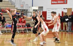 BOY'S BASKETBALL FALLS TO MOSCOW