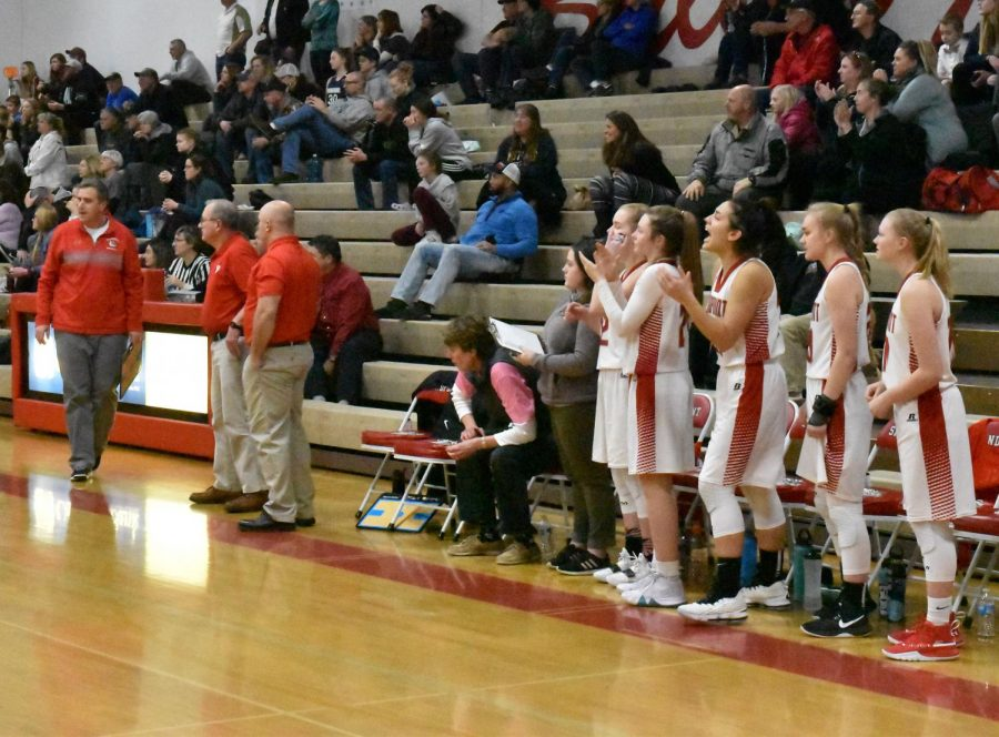 Sandpoint bench cheers for their teammates.