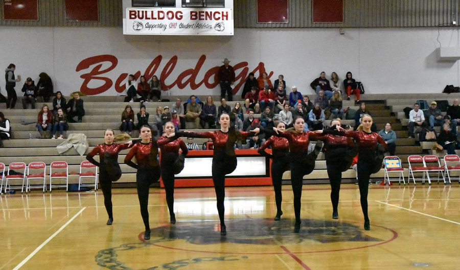 The+SHS+Dance+Team+does+a+kick+line+during+the+halftime+of+the+boys+varsity+basketball+game.