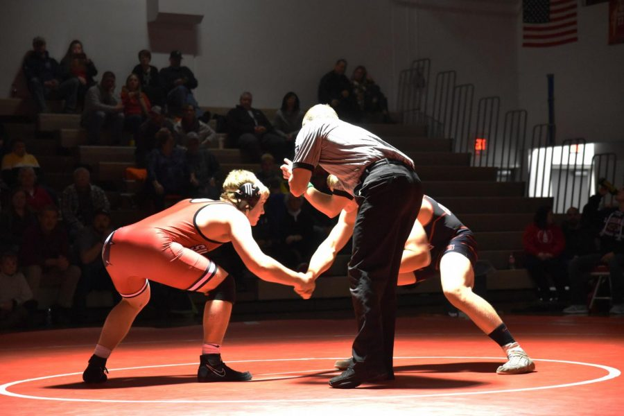 Jake+Suhr+shakes+his+opponents+hand+before+the+match.