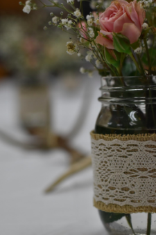 Flower arrangements adorn the party tables at the baby shower.