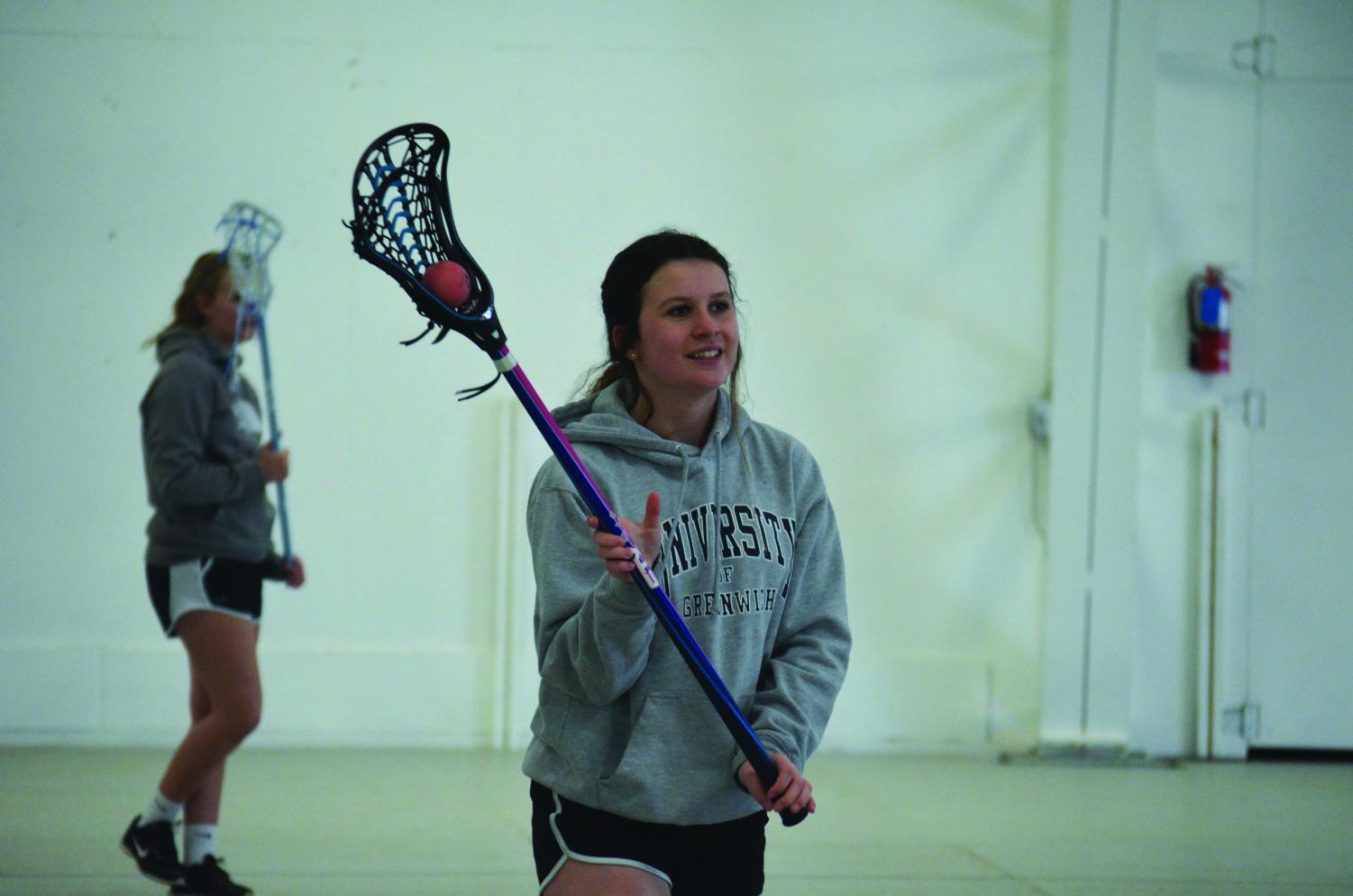 Sophomore starter Ellen Clark catches the ball in the pocket during her weekly lacrosse practice at the Bonner County Fairgrounds in Ponderay, Idaho.