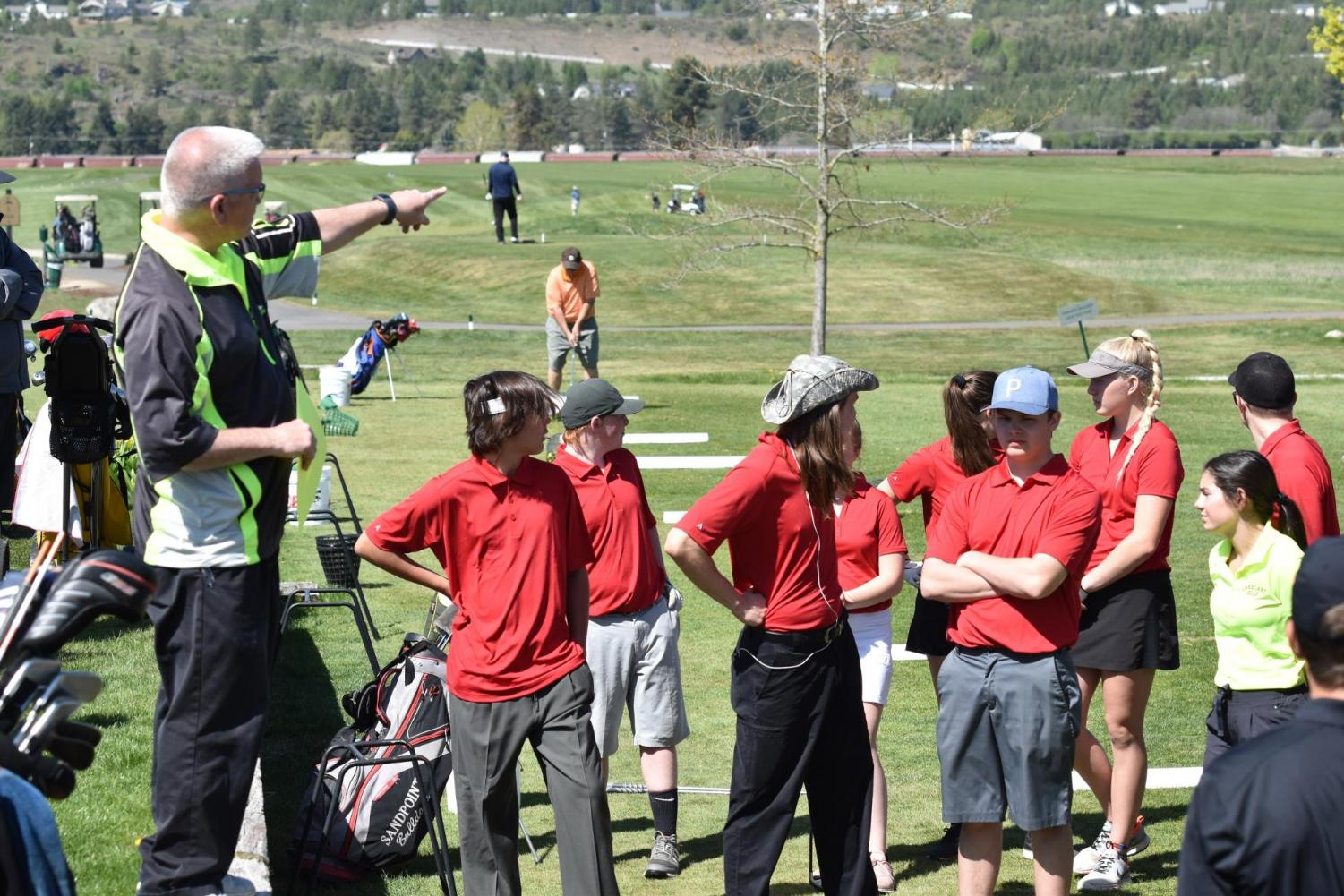 Golf+players+are+briefed+about+the+course+before+the+tournament+starts.