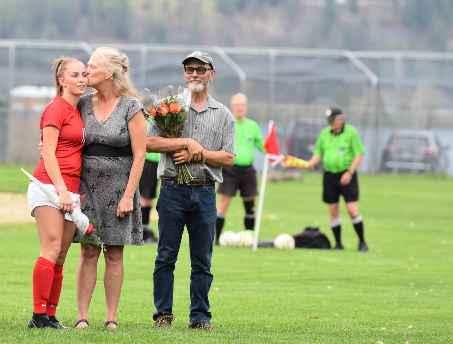 Senior+Emi+Lynch+is+embraced+by+her+mom+after+being+recognized+at+Senior+Night.