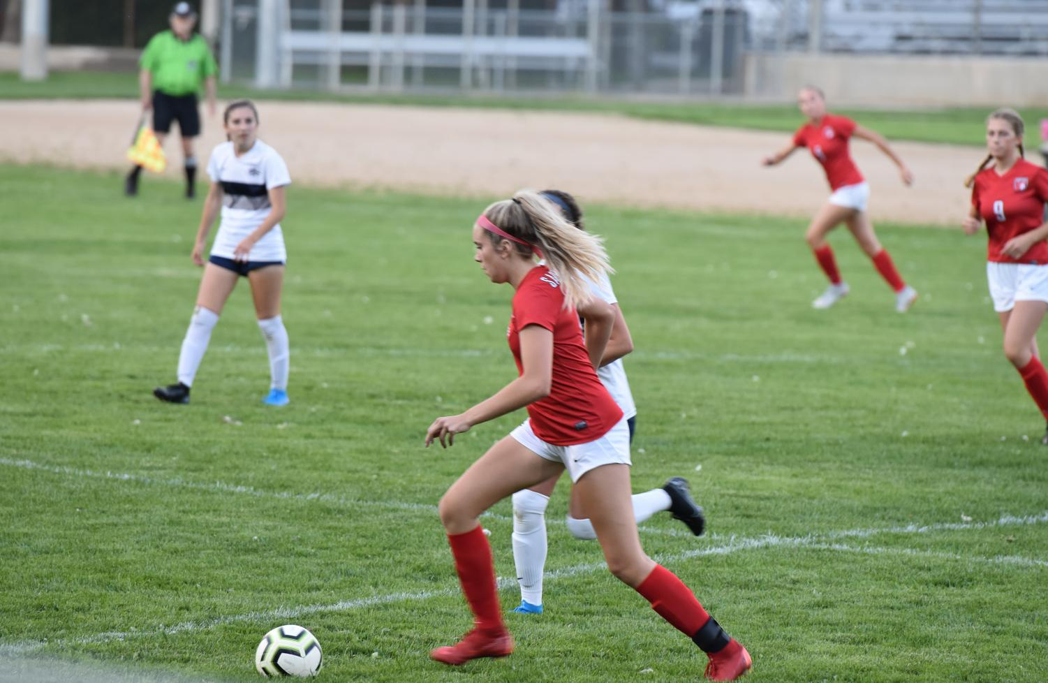 Sophomore+Emma+Thielbahr+dribbles+past+an+opponent+and+looks+to+counter-attack+after+Lake+City+makes+the+score+2-0+in+the+second+half.+