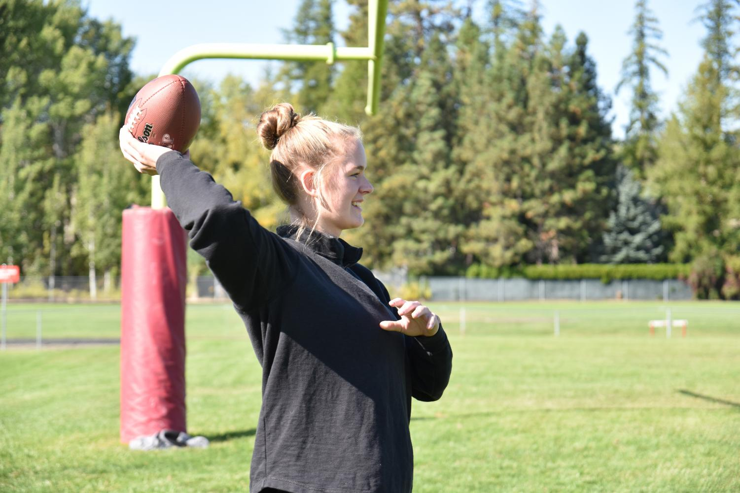 Senior Brooklen Steiger throws the ball to a teammate during their first practice of the year.