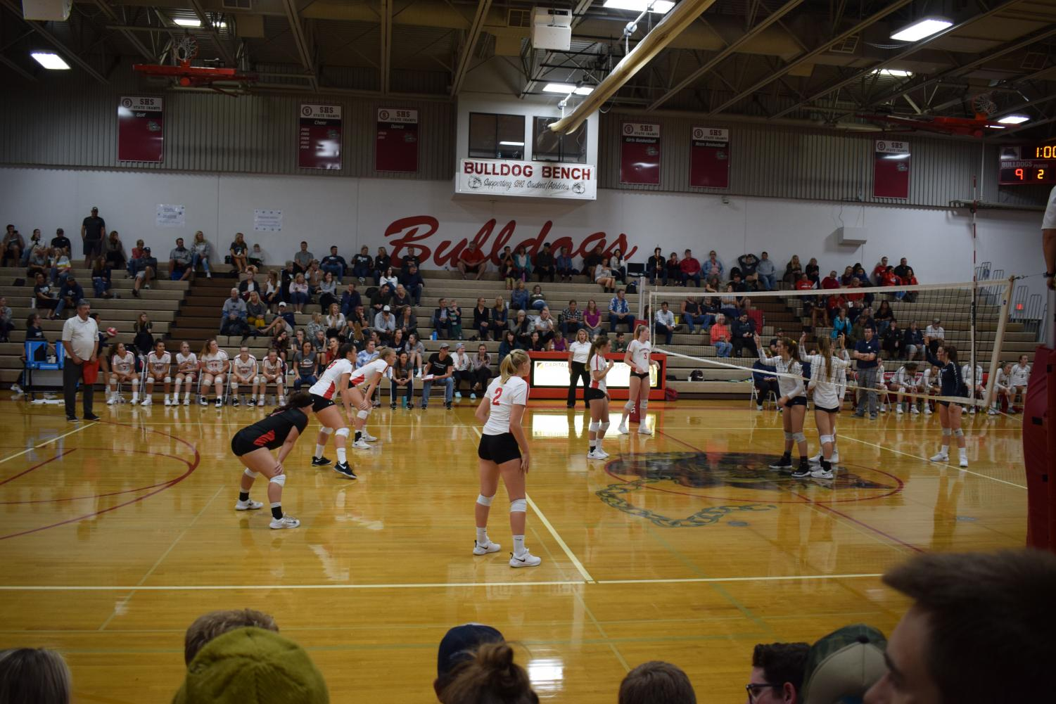 The+varsity+volleyball+team+prepares+to+receive+the+serve.