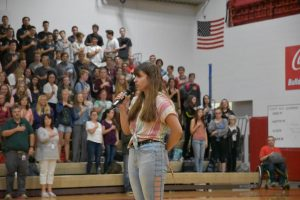 Senior Jaida Donaldson sings the National Anthem for the first day of school assembly in front of over one thousand students and faculty.