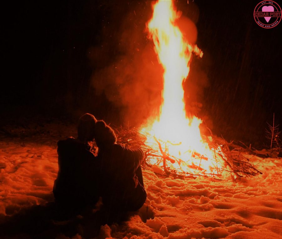 A couple depicting what a bonfire on Valentine's Day might look like.
