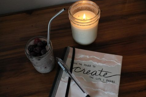 One of the ways you can boost your mood is by setting up a relaxing space and journaling.
