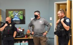 Ryan Root (right), Derek Dickinson (middle), and Spencer Smith (left) attend Officer Smith's going away party.