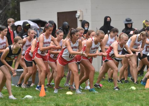 The girls team lines up and gets ready for the start their home meet race.