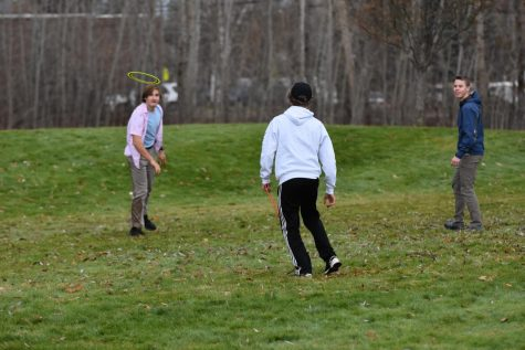 Kylan Blaser, Hayden Norling, and John Keegan engage in their daily game of frisbee.